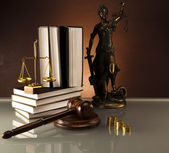 Statue of Lady Justice, gavel and books, gold coins — Stock Photo