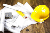 Construction equipment on blueprints — Stock Photo