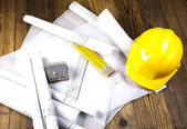 Building and construction equipment on blueprints — Stock Photo