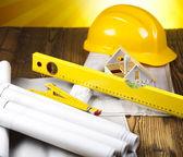 Construction equipment on blueprints — Stock Photo