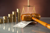 Golden scales of justice, gavel and books ,coins,hourglass — Stock Photo