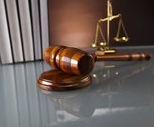 Golden scales of justice, gavel and books — Stock Photo