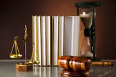 Wooden gavel and book, Statue of Lady Justice, hourglass — Stock Photo