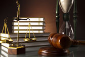 Golden scales of justice, gavel and books ,coins,Legal hourglass — Stock Photo