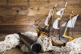Pirate ship, chests of gold, net, telescope — Stock Photo