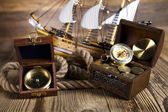 Pirate ship, chest of gold, compas — Stock Photo