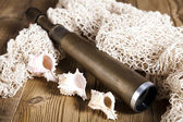 Telescope, shells on the network — Stock Photo
