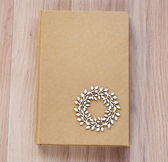 Diary with wooden embellishment on cover — Stock Photo