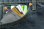 Credit cards in blue jeans pocket — Stock Photo