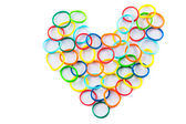 Heart shape of colorful hair bands — Stock Photo