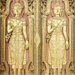 Thai sculpture style on temple door — Stock Photo #44958579