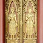 Thai sculpture style on temple door — Stock Photo #44959153