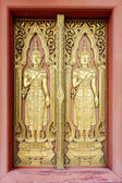 Thai sculpture style on temple door — Stock Photo