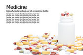 Colourful Medical pills spilling out of a medicine bottle — Stock Photo