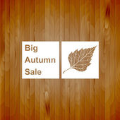Big autumn sale sign, white silhouette on wood background, vector illustration — Stock Vector