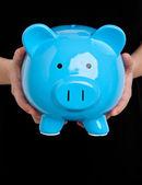 Holding a Piggy Bank — Stock Photo