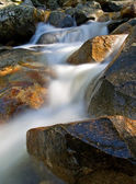 Waterfall movement on the rocks — Stock Photo