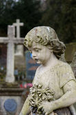 Statue of baby angel on the graveyard — Stock Photo