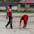 Local african soccer team during training on sand playing field — Stock Photo