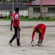 Local african soccer team during training on sand playing field — Photo