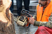 Artist carving wood with chainsaw during euromaidan in ukraine — Stock Photo