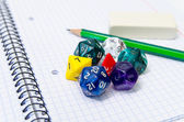 Set of open exercise book, pencil, rubber and dices isolated on — Stock Photo