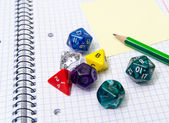 Role playing dices lying on exercise book — Stockfoto