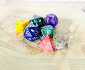 Role playing dices lying on picture background — Stock Photo