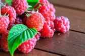 Closeup of raspberry on wooden table — Stok fotoğraf