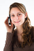 Isolated portrait of a young telephone operator — Stockfoto