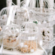 Stock Photo: Bird cages on chair.