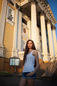 Girl near building — Stock Photo