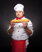 Baker with bread — Stock Photo