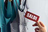 Saldi with woman hand — Stockfoto