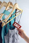 Sale tag elegant clothes — Stockfoto