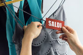 Saldi with woman hand — Stock Photo