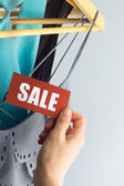 Sale with hand — Stockfoto