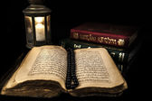Quran Books And Candle — Stock Photo