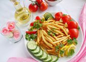 Fried potatoes and vegetables — Stock Photo