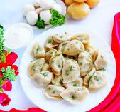 Vareniks with mush rooms and potatoes — Stock Photo