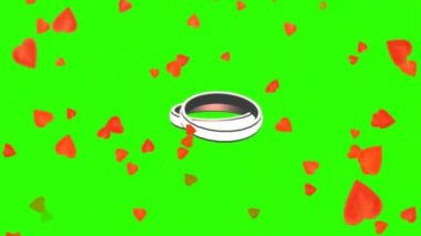 Rotating wedding rings between falling hearts - green screen — Stock Video