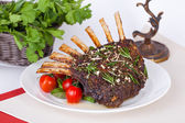 Rack of lamb with tomatoes — Foto de Stock