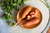 Corndog with mustard, ketchup and parsley — Stock Photo