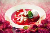 Strawberry soup with ice cream and mint — Stock Photo