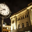 Night photo of the street and facade of the illuminated building — Stock Photo