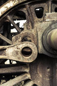 A wheel from an old style railway engine - steam locomotive. — Stock Photo