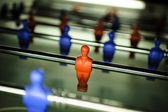 A figure of a table football player in the red colour on the toy — Stock Photo