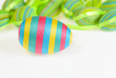 Easter decorated striped eggs on white background. — Stock Photo