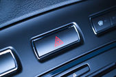 Vehicle, car hazard warning flashers button with visible red triangle. — Stock Photo