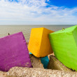Three colourful blocks of a concrete breakwater by the sea. — Stock Photo #42008023